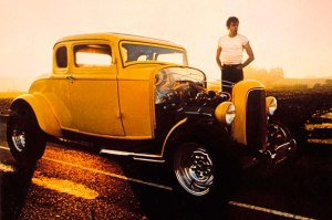 Movie still from American Graffiti showing fancy hot rod car