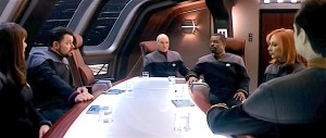 Science fiction (Star Trek) with officers sitting around a meeting table.